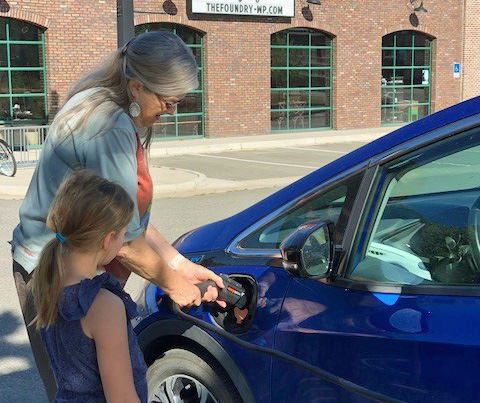Fraser Board member charges her electric vehicle