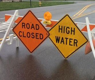 water-high-road-closed warning signs