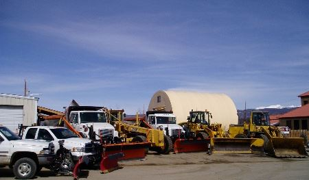 Image of snow plows and equipment in parking lot
